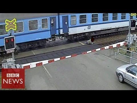 CCTV: Czech man nearly hit by train – BBC News