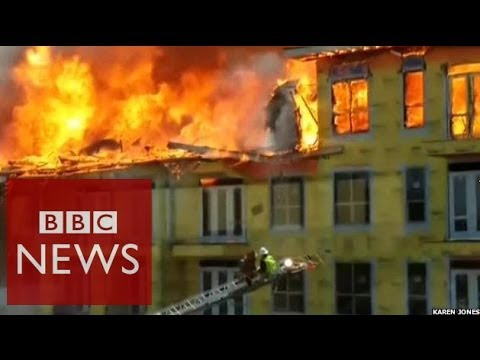 Man rescued as burning building falls in Texas – BBC News