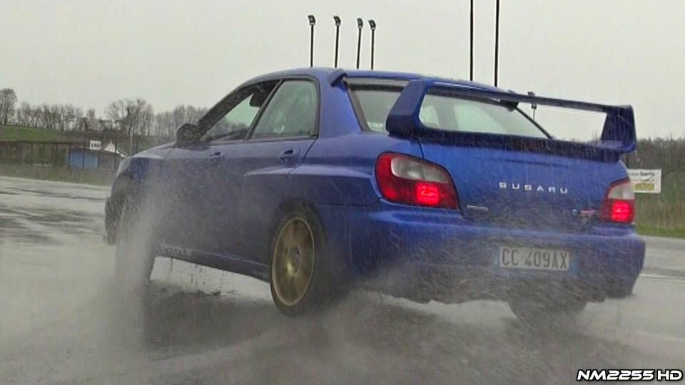 Modified Subaru Impreza STi Powersliding on Wet