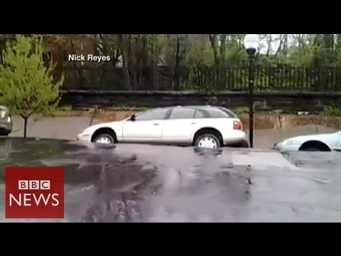 Moment US sinkhole swallows cars – BBC News