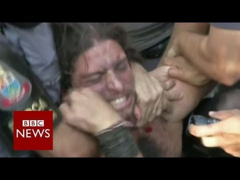 Police use tear gas to break up World Cup protest – BBC News